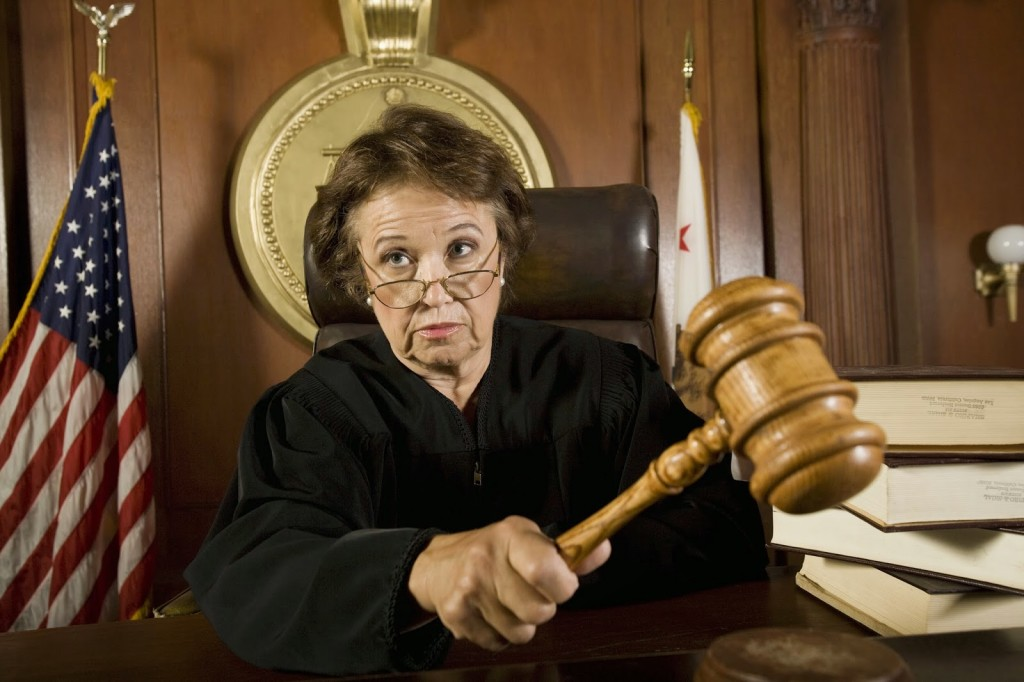older female judge with gavel